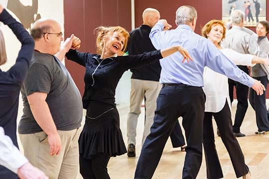 Couples learning to dance at Destiny Dance